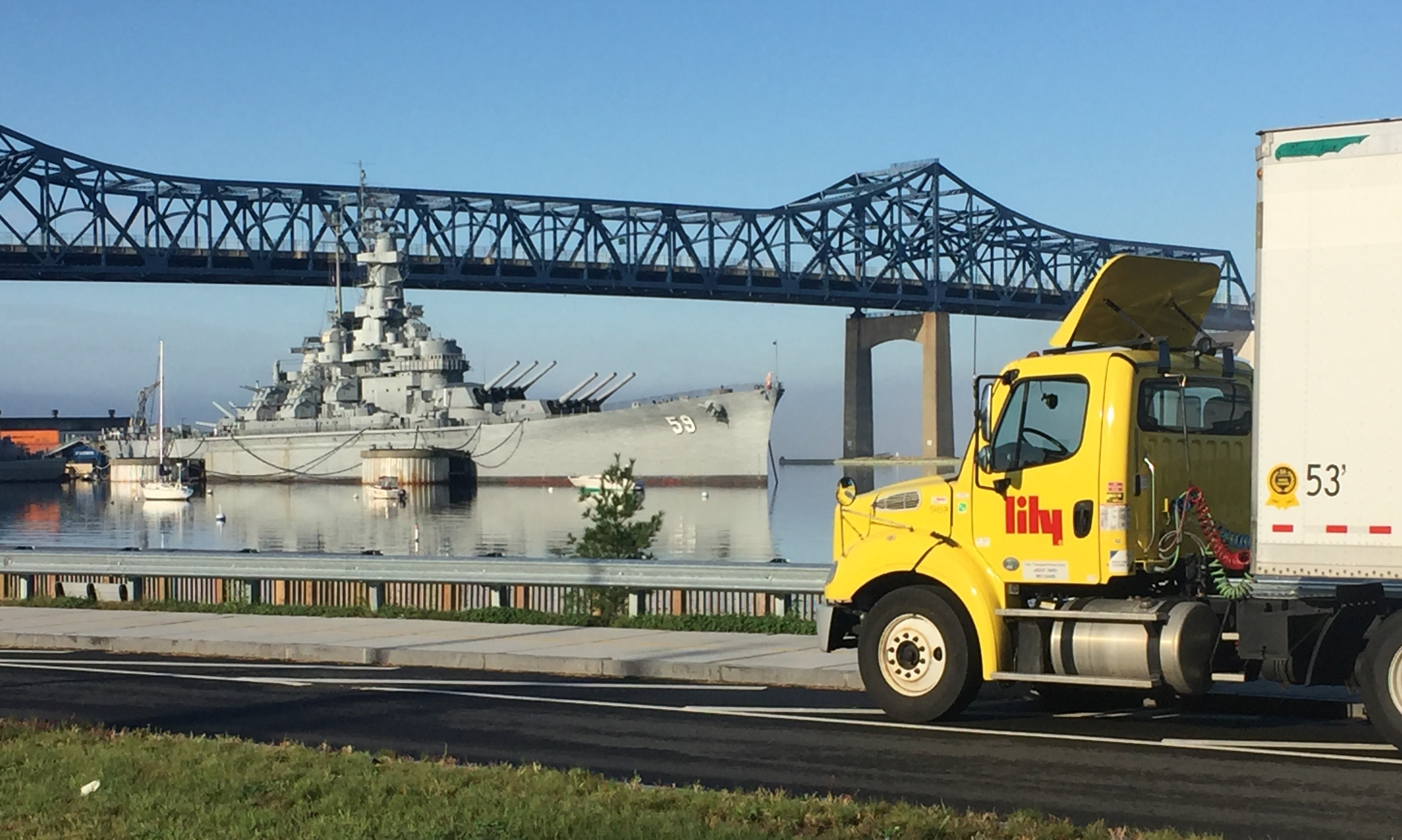 Lily truck driving past Navy vessel-1