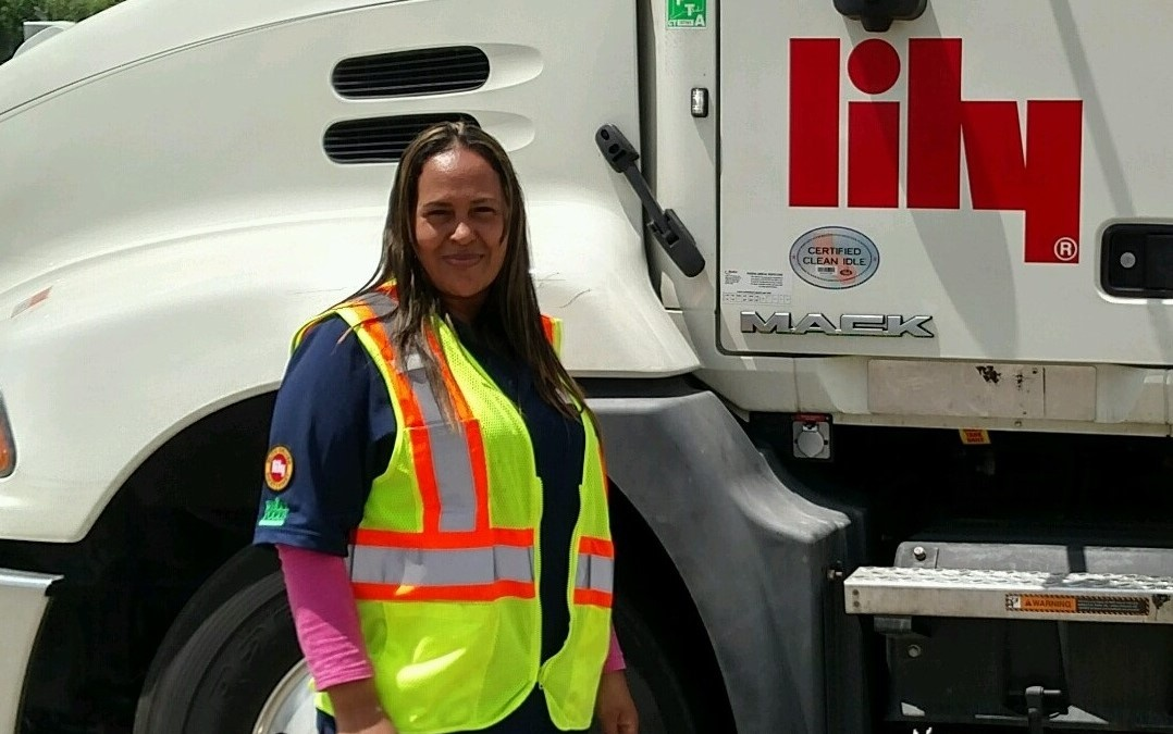 Yessica standing in front of Lily truck