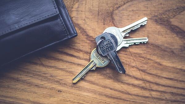 keys and wallet on a wooden table