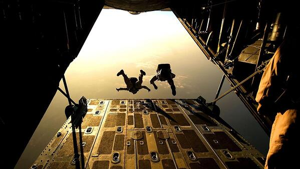 soldiers jumping out of airplane