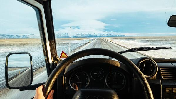 truck driver behind the wheel on a snowy road