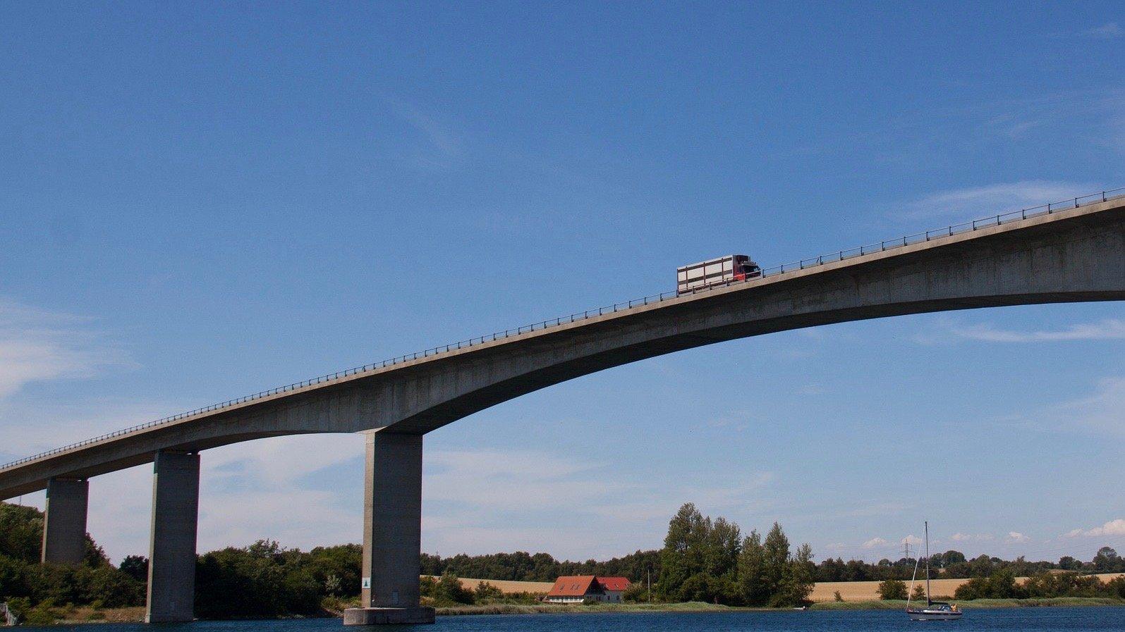truck driving over bridge