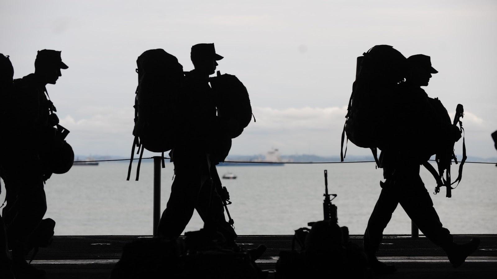 military men walking