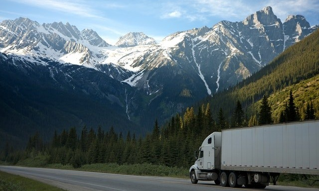 truck driving under mountain range is what to look for in a trucking job