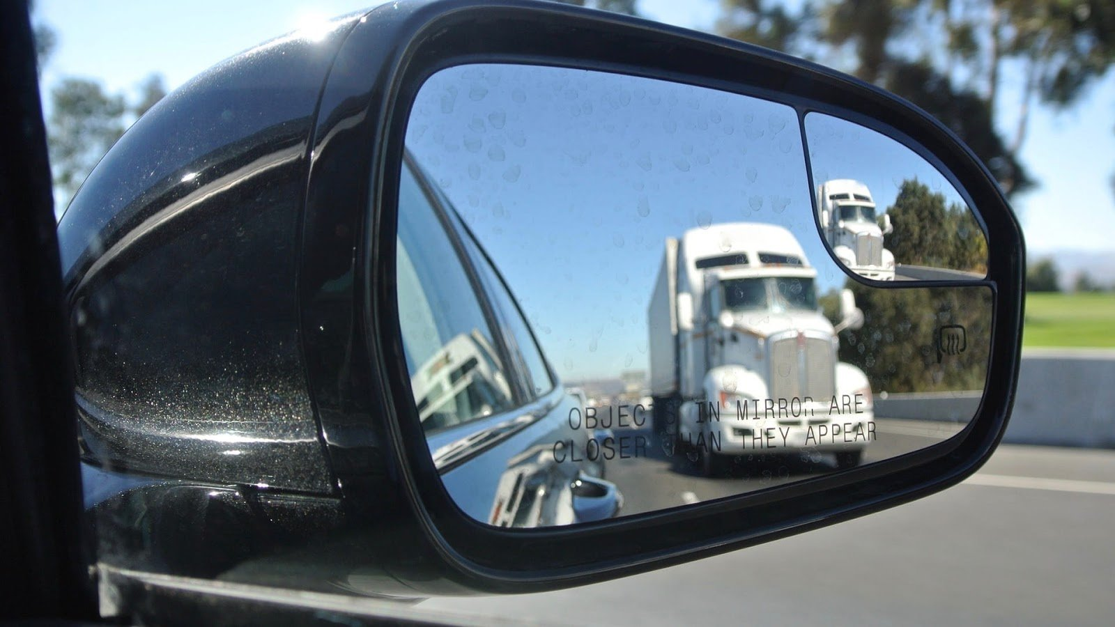 truck in side-view mirror